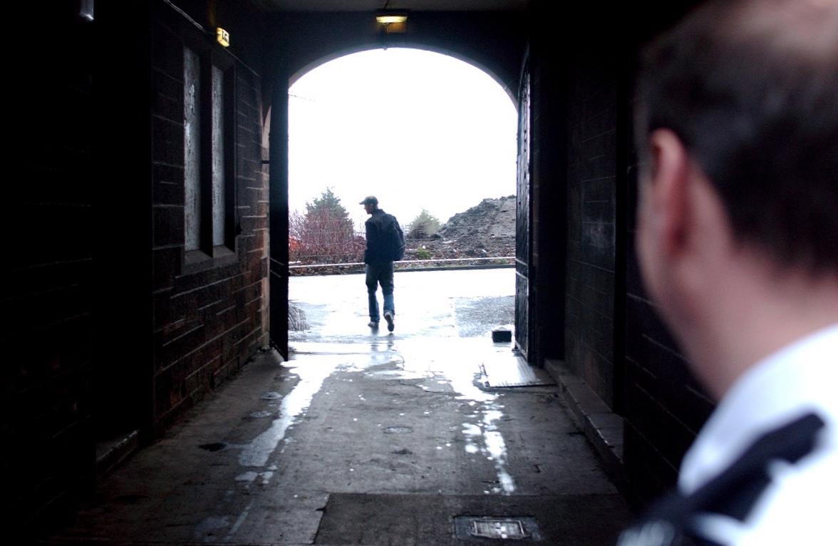 Scene depicts man leaving prison